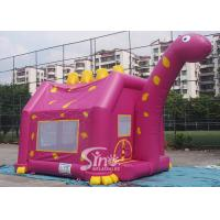 China Outdoor children playground Dino inflatable bouncy castle with obstacles inside made of 1st class pvc tarpaulin on sale