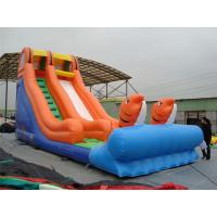 China Rotating Large Inflatable Slide With Inflatable Trampoline Jumping Bouncer on sale