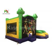 China EN71 Justice League Theme Green Inflatable Jumping Castle With Slide For Kids on sale