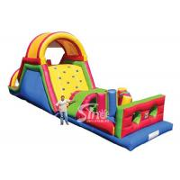 China Outdoor commercial rainbow kids inflatable obstacle course with big slide suitable for inflatable rentals on sale