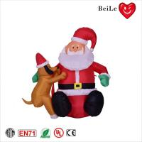 Wholesale 1ML New design Christmas indoor decoration dog next to inflatable Santa Claus from china suppliers